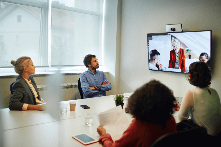 People in a conference room watch a presentation