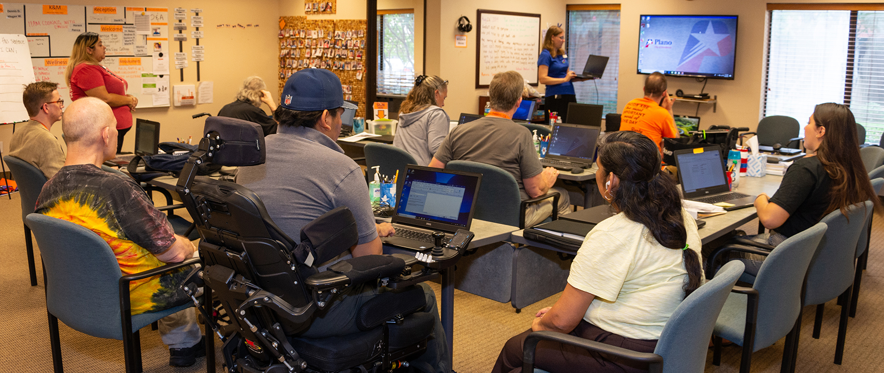 Plano Public Library staffers teach a technology class at the Brain Injury Network of Dallas